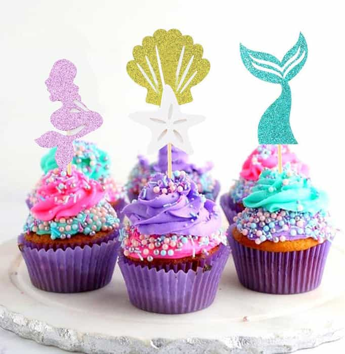 image contains cake toppers with mermaid designs